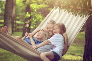 Family sitting in hammock - Mosquito free